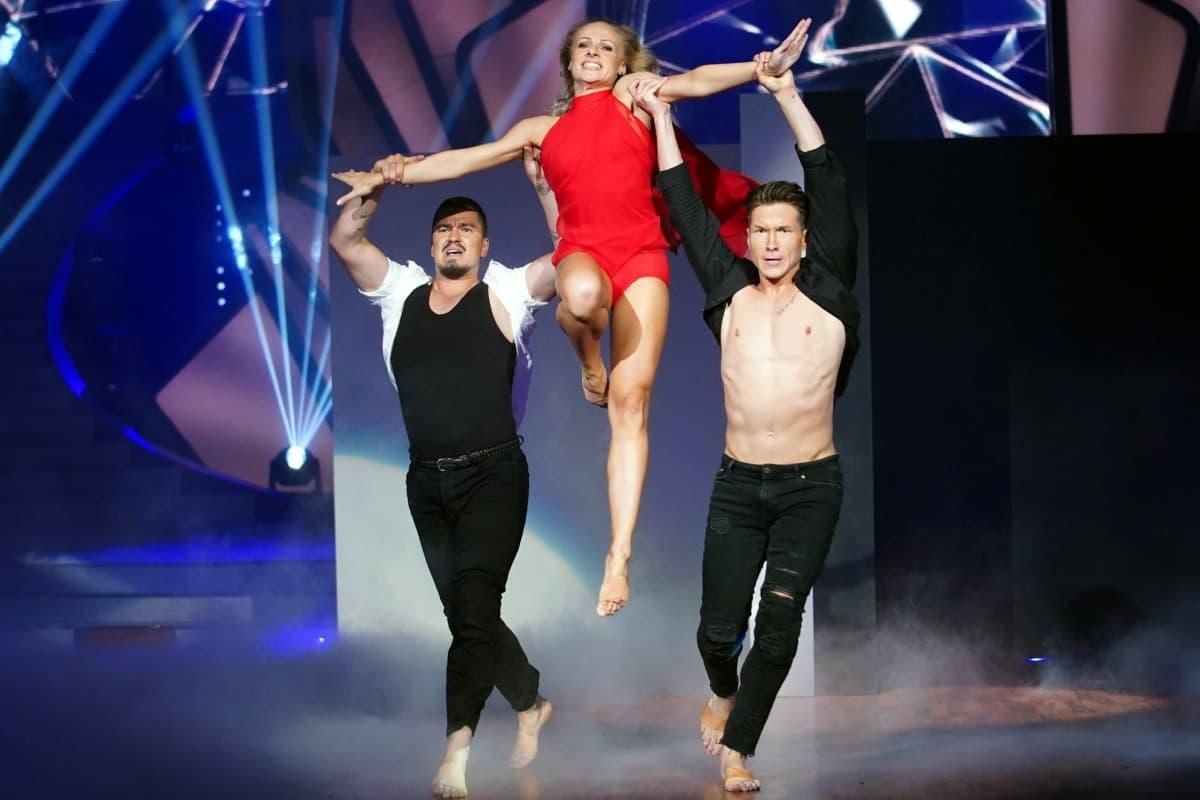Marta Arndt mit Evgenij Vozniuk und Evgeny Vinokurov